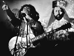Marley performs in front of scrim of Ras Tafari (Haile Selassie)