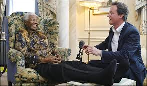 Mandela and British Tory prime minister David Cameron.  Twenty-five years ago, the Tories, and their co-thinkers around the world, denounced Mandela as a 'terrorist'.