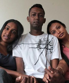 Sanil Kumar, flanked by cousins Asheelta Kumar, left, and Ashika Aujla