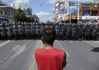 Over the last six months an average of around 100 strikes and worker protests have been recorded every month in China – and this is just the tip of the iceberg. (AP/Eugene Hoshiko)