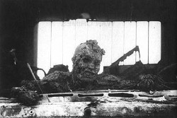 Incinerated Iraqi soldier on the 'Highway of Death', 1991; despite Iraq having already agreed to pull out of Kuwait and its forces leaving, the US attacked the departing Iraqis, bombing, strafing and incinerating them for hours