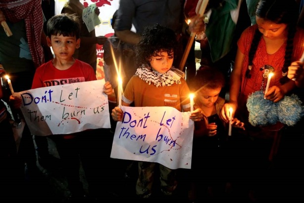 Palestinian children protest against the killing of 18-month-old Palestinian Ali Saad Dawabsheh, a toddler who was burnt to death by suspected Jewish extremists in the northern Gaza Strip. PHOTO: ASSOCIATED PRESS