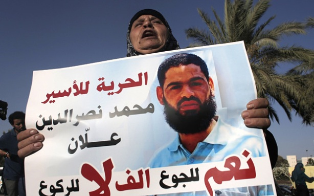 "Maazouze, the mother of Mohammed Allaan, a Palestinian prisoner who is on a long-term hunger strike, holds a portrait of her son during a rally calling for his release in the southern Israeli city of Beersheva on August 9, 2015. The International Committee of the Red Cross warned on August 7 that the alleged Islamic Jihad activist, held without charge since November, was ""at immediate risk"" of death after fasting for 50 days. AFP PHOTO / AHMAD GHARABLIAHMAD GHARABLI/AFP/Getty Images"
