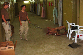 US soldiers humiliating and torturing prisoners at Abu Ghraib
