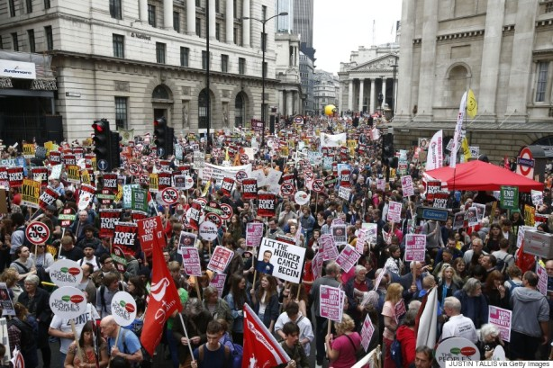 Demonstrators crowd the area around the Bank of England as they gather for the start of a protest against the British government's spending cuts and austerity measures in London on June 20, 2015. The national demonstration against austerity was organised by People's Assembly against government spending cuts. AFP PHOTO / JUSTIN TALLIS (Photo credit should read JUSTIN TALLIS/AFP/Getty Images)